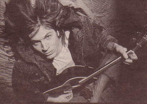 evan dando lying with guitar.jpg