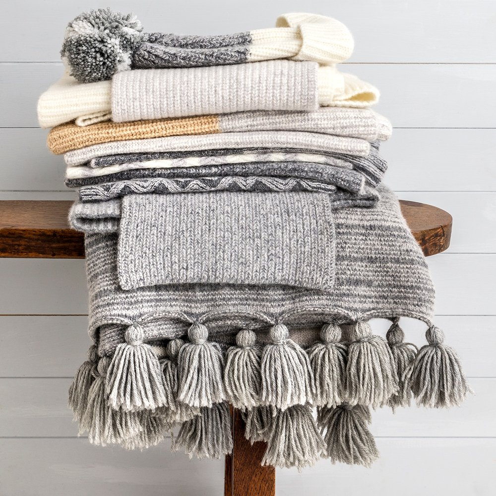 Pile of knitwear by Amber Hards