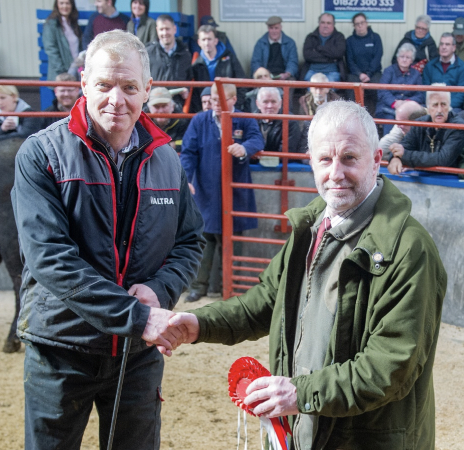 Ian Goldie receiving the Championship rosette from Jim Holden of Morrisons