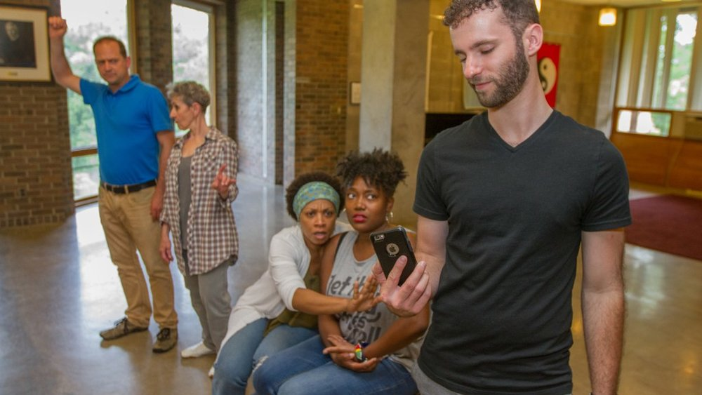"Performance Educators on a ""subway,"" using Image Theatre to explore bystander intervention"