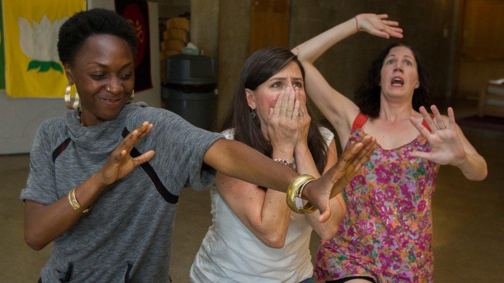 "Impact performance educators using ""Fluid Sculptures"" to play back a program participant's story."