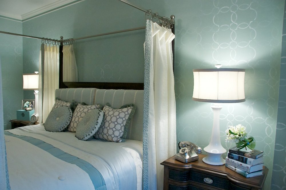 Functional bedside tables, custom bedding, and soft lighting set the mood.