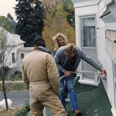 Blowing insulation into siding, Minneapolis (ca. 1987)