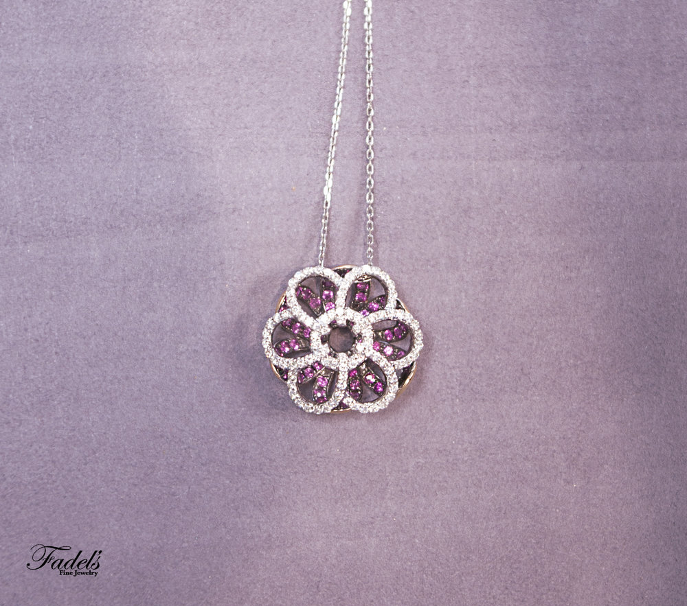 Flower pendent with pink sapphires and diamonds.JPG