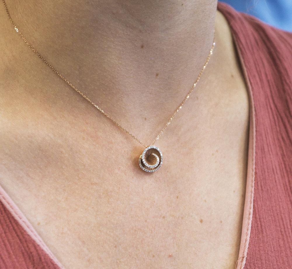 rose gold swirl with diamond pendent.JPG