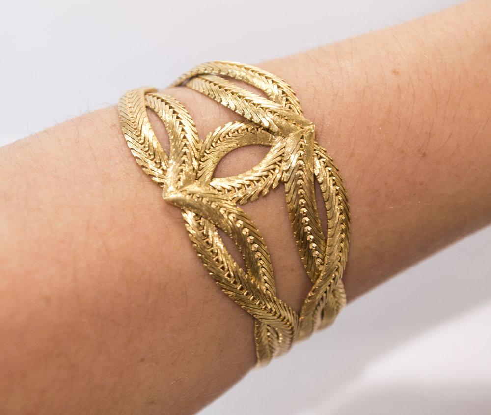Estate 18ky bracelet with design center, on a wrist.JPG