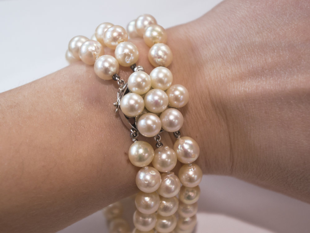 Estate 14KW Pearl Bracelet with Diamonds on wrist - Copy.JPG