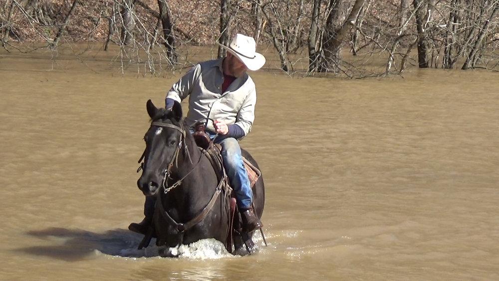 Mo in the flood waters.Movie_Snapshot.jpg