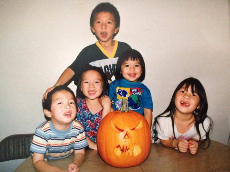 I'm the one with the blue sweatshirt. With my four siblings.