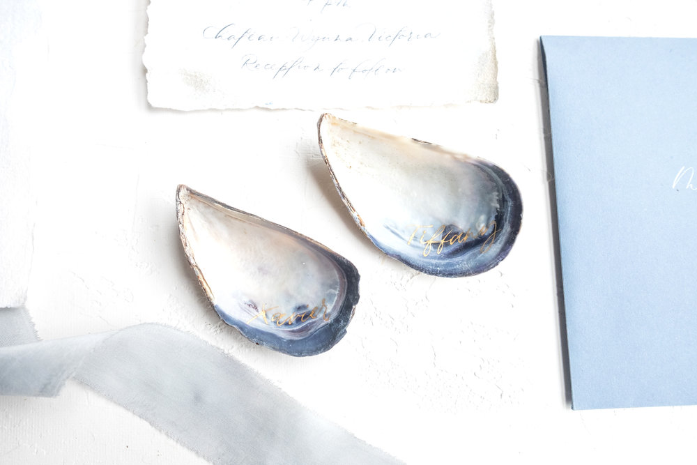 Gold calligraphy on mussel shells