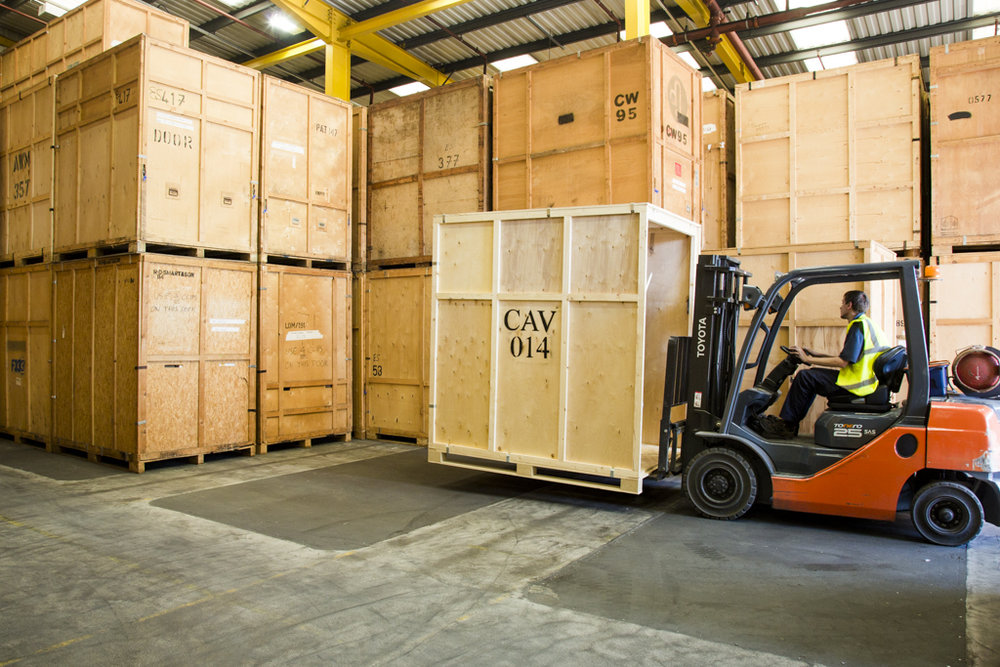 Storage Containers - Our storage warehouse is based outside of London; offering secure storage well-suited to customers with medium to long-term storage needs. Each wooden container holds 250 cubic feet of contents and is stored in an alarmed and monitored facility.
