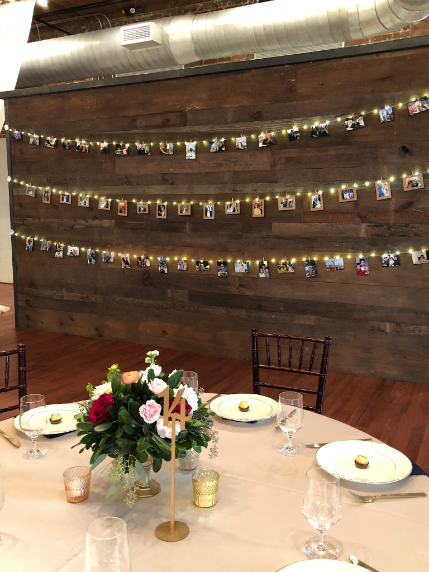 On the wall behind this lovely table setting are rows of multi-generational wedding photos from Anthony's and Lynn's families.