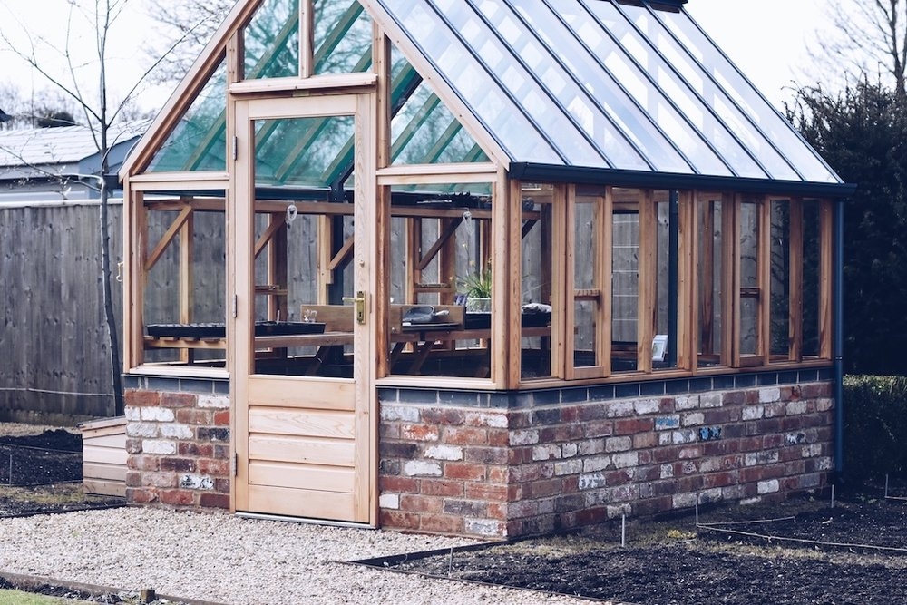my new greenhouse is beautiful. Though the vegetable garden is currently empty the potential is huge and so exciting