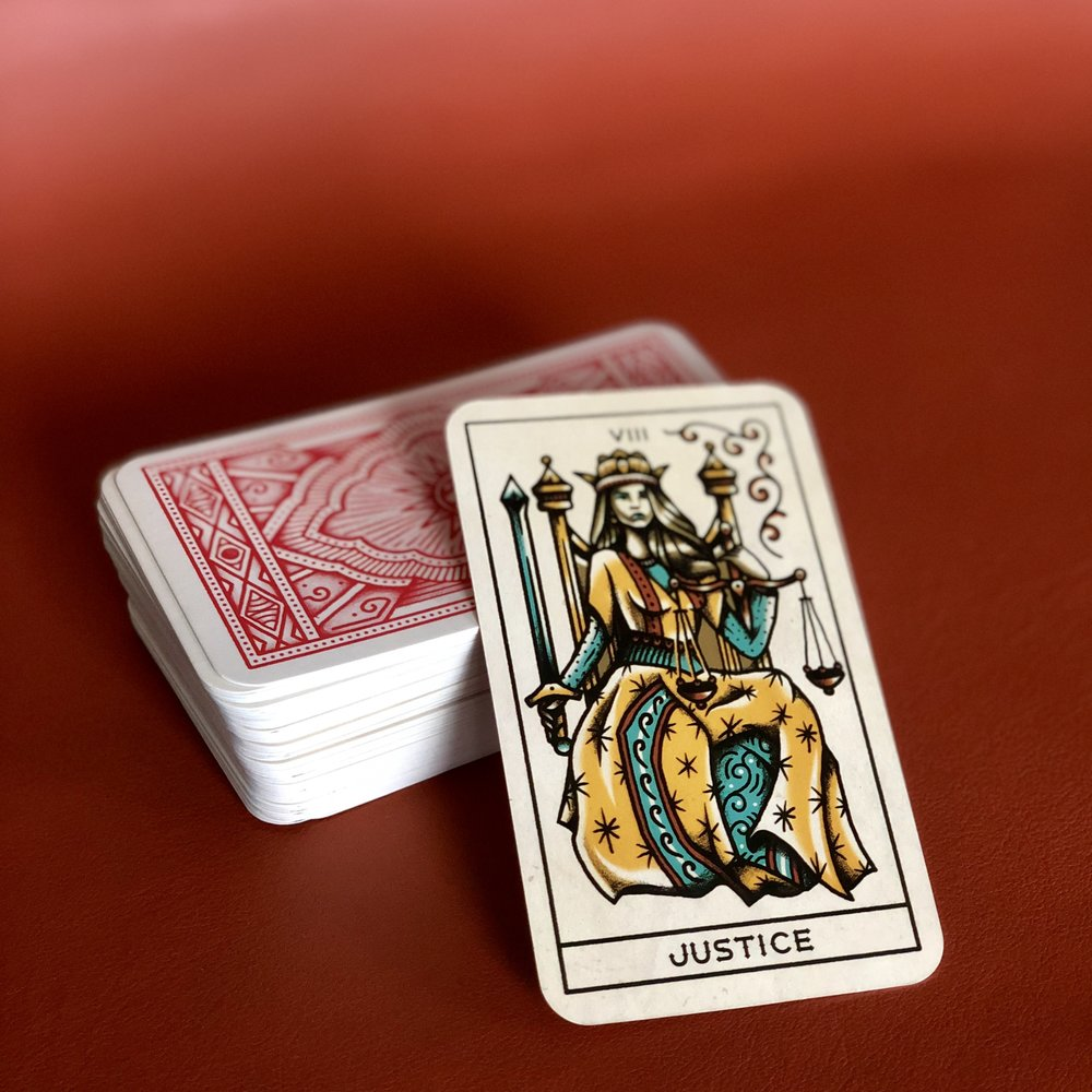 In this deck, Lady Justice gives zero fxcks.