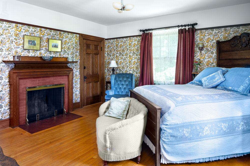 Room Three - Experience a sense of grandeur and romance in Room Three, which is furnished with a tall oak queen bed. This room has a tiled, private bathroom with shower for your convenience. Room Three may adjoin Room Four, if you're interested.