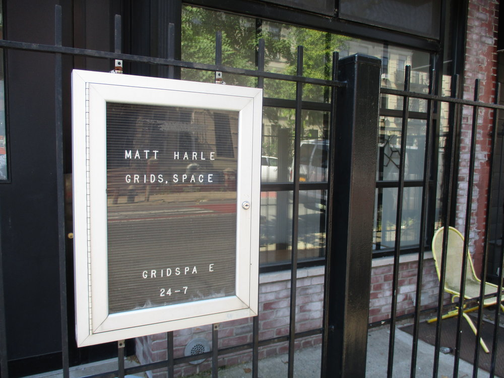 Gridspace owned my Charles Goldman is locate at 112 Rogers Avenue. Gridspace shows art primarily in the front window. Cloudy days are ideal for viewing.