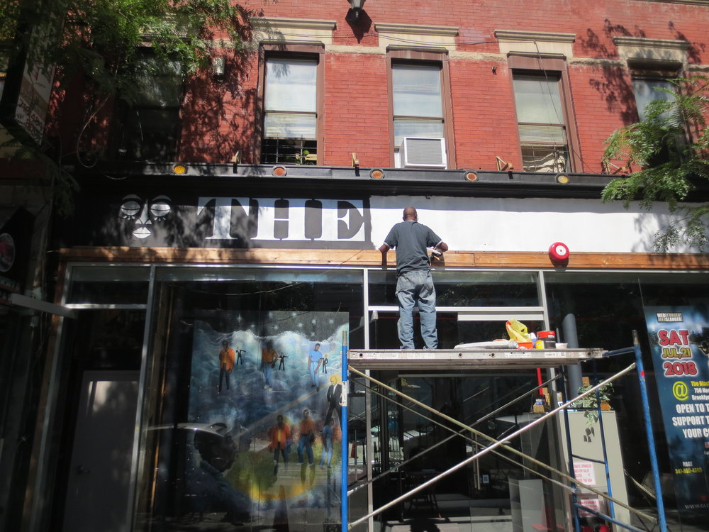 The Black Lady Theatre at 750 Nostrand as the new sign was being painted. With the reopening of The Black Theatre there is now a place on Nostrand Avenue putting on interesting and important plays.