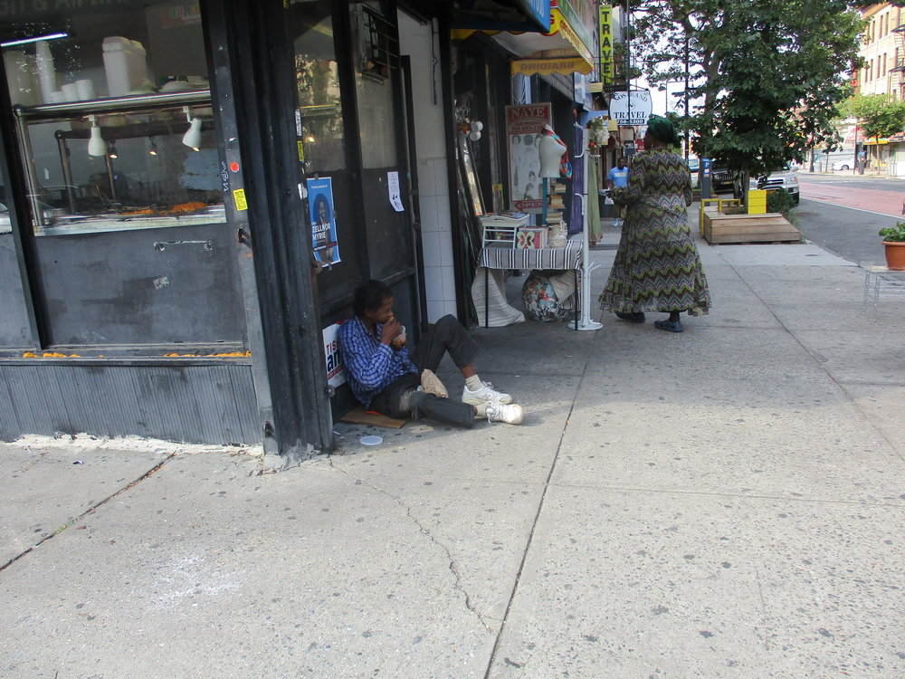 Regular beggar asking for food on Nostrand Avenue