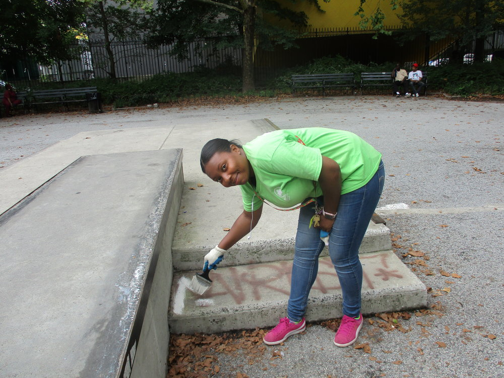A worker from the Parks Department painting over graffitti in Brower Park.