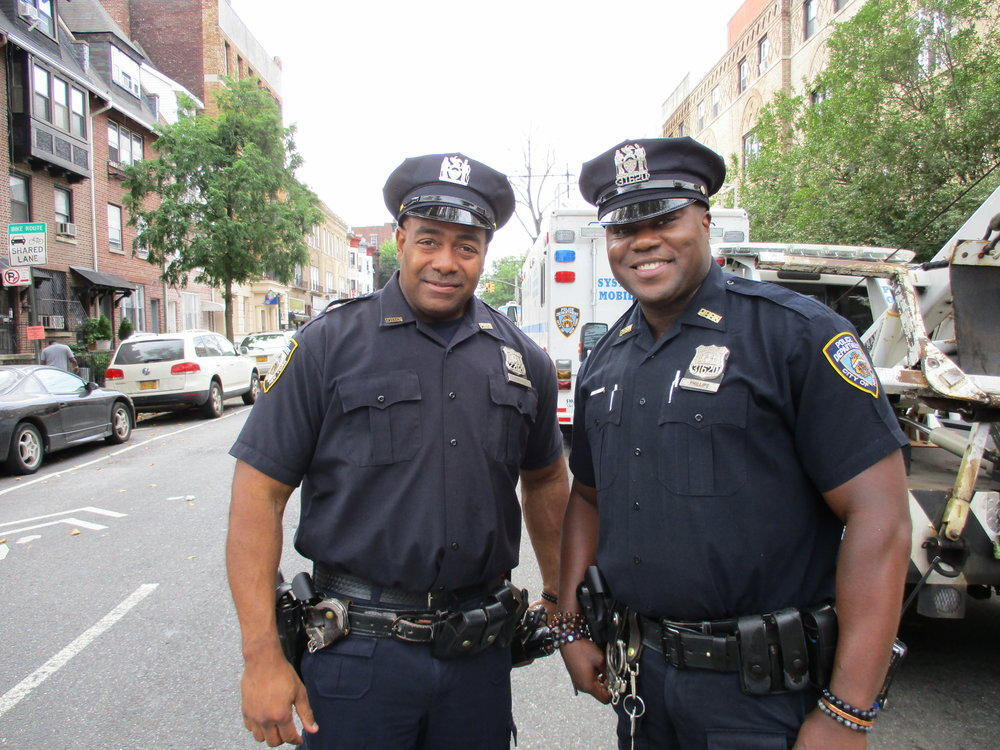 Two policemen on duty at the Children's Caribbean Day parade.