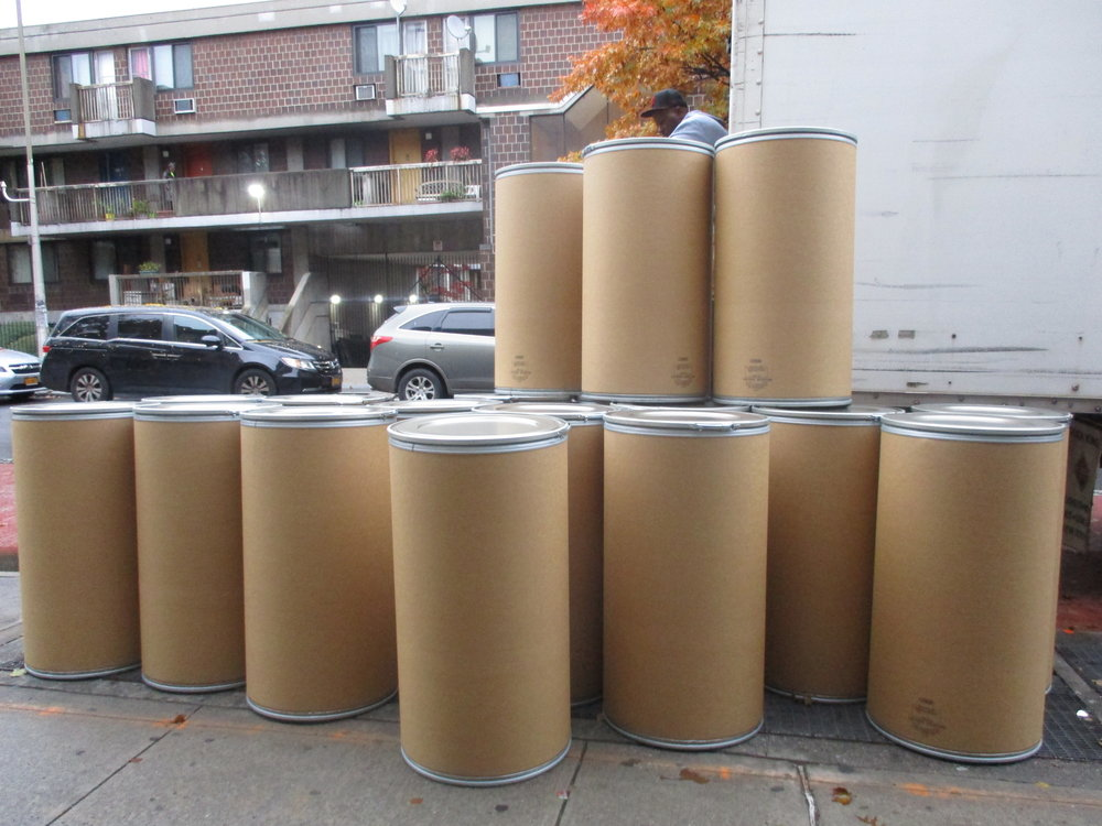Storage drums on Nostrand Avenue for clothes