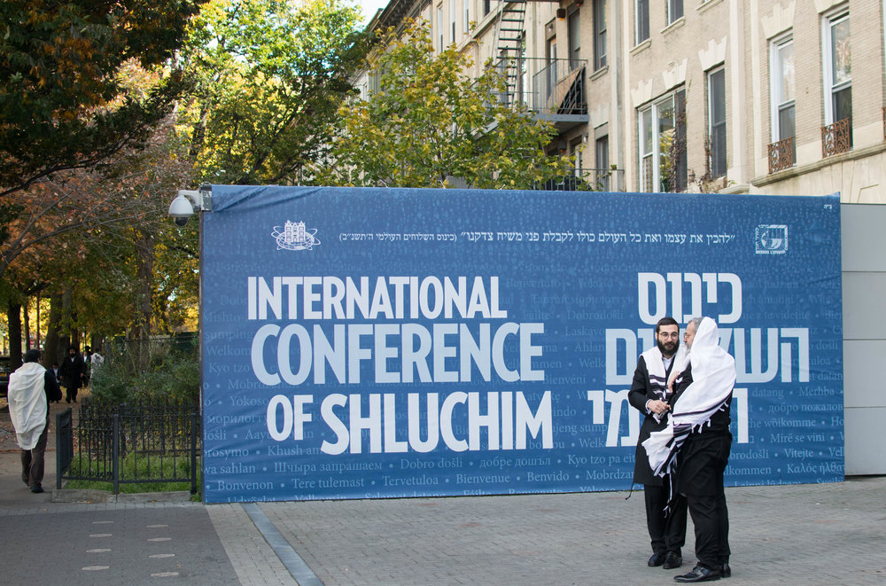 Hasidic men during a global rabbi conference