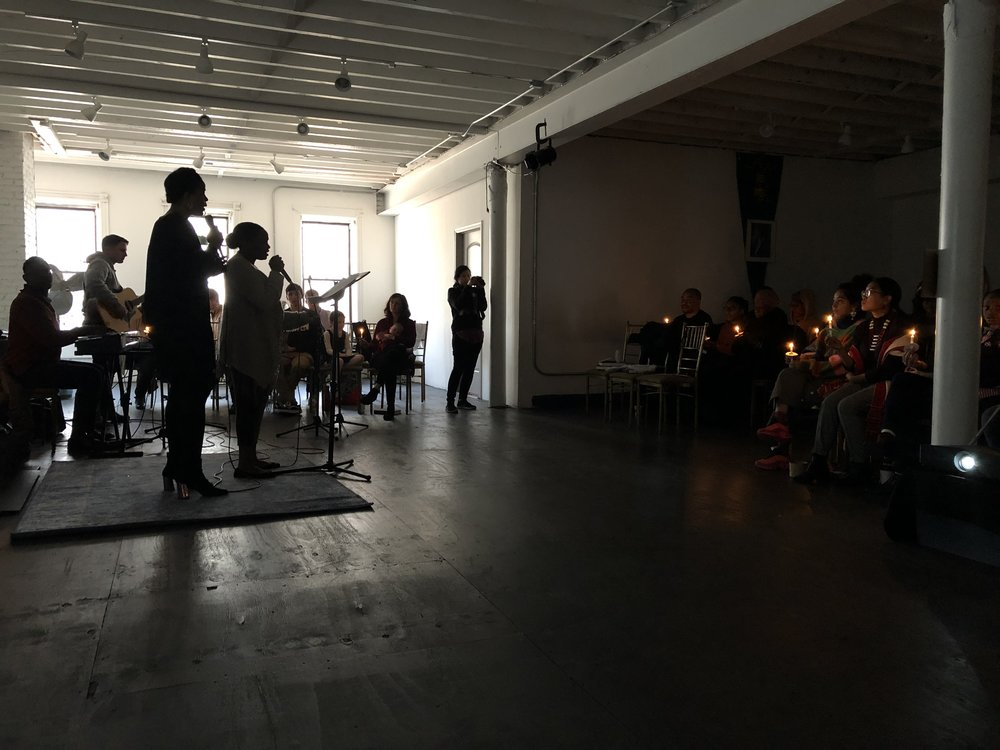 The service included song enhanced by the congregation holding lighted candles.