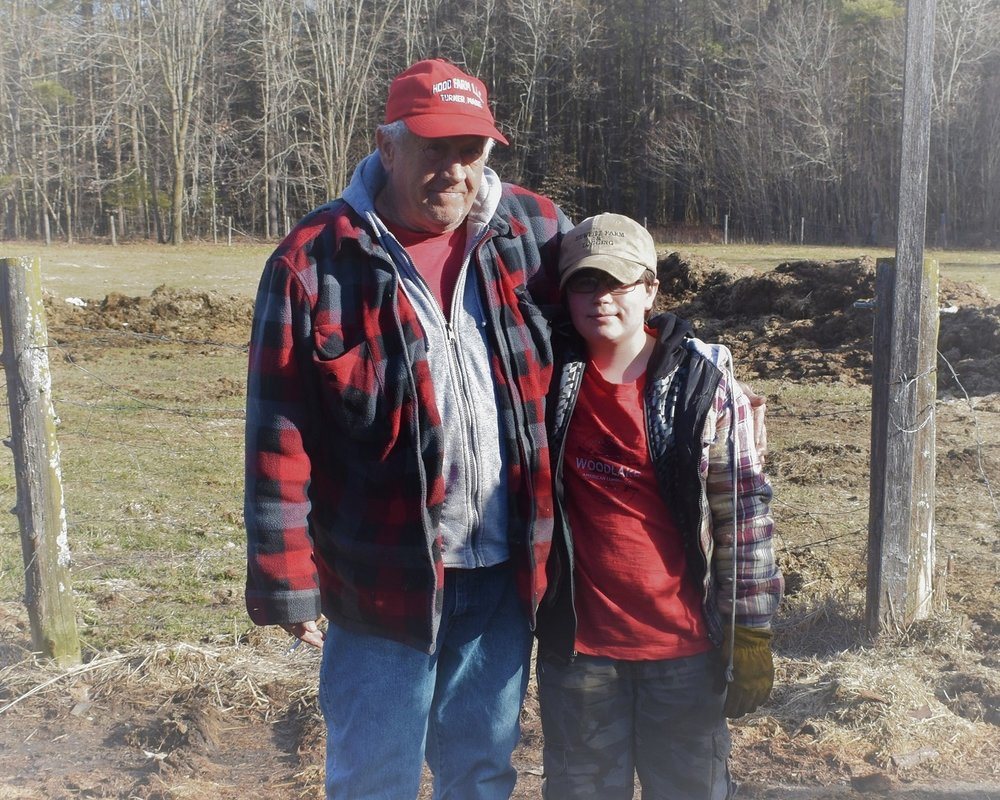 Skowhegan Farmer Tim Hewett, 2019 Outstanding Farmer, with helper Kadin.  Laura Suomi-Lecker photo.
