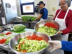 At Food for Thought in Mentor, prep workers at salad stations cut, slice and dice copious amounts of fresh vegetables. Janet Podolak — The News-Herald