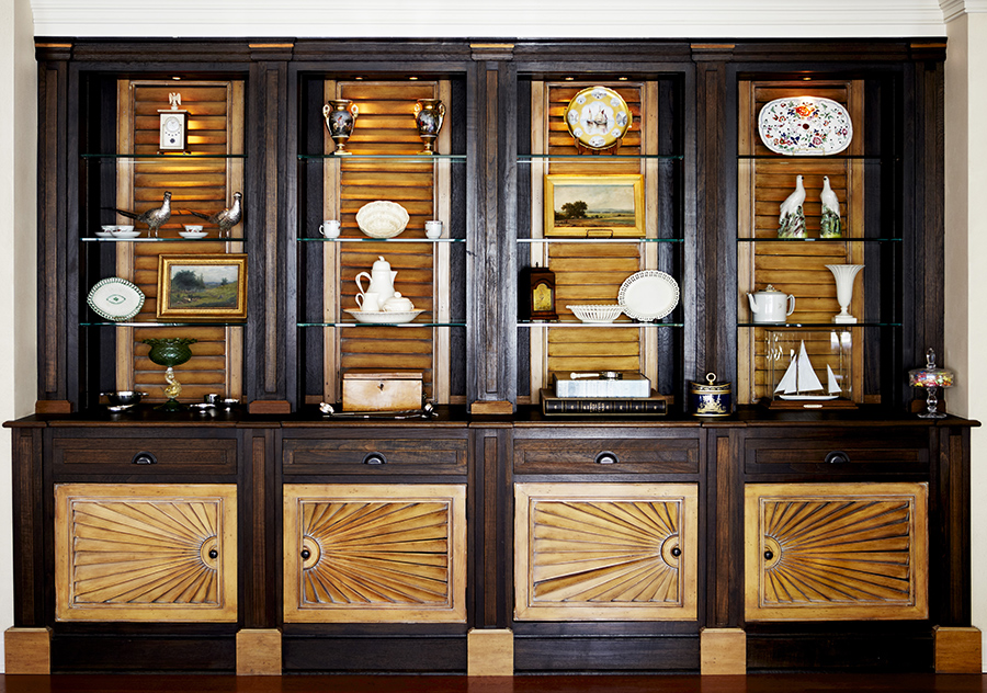 Unusual shutters incorporated into cabinetry