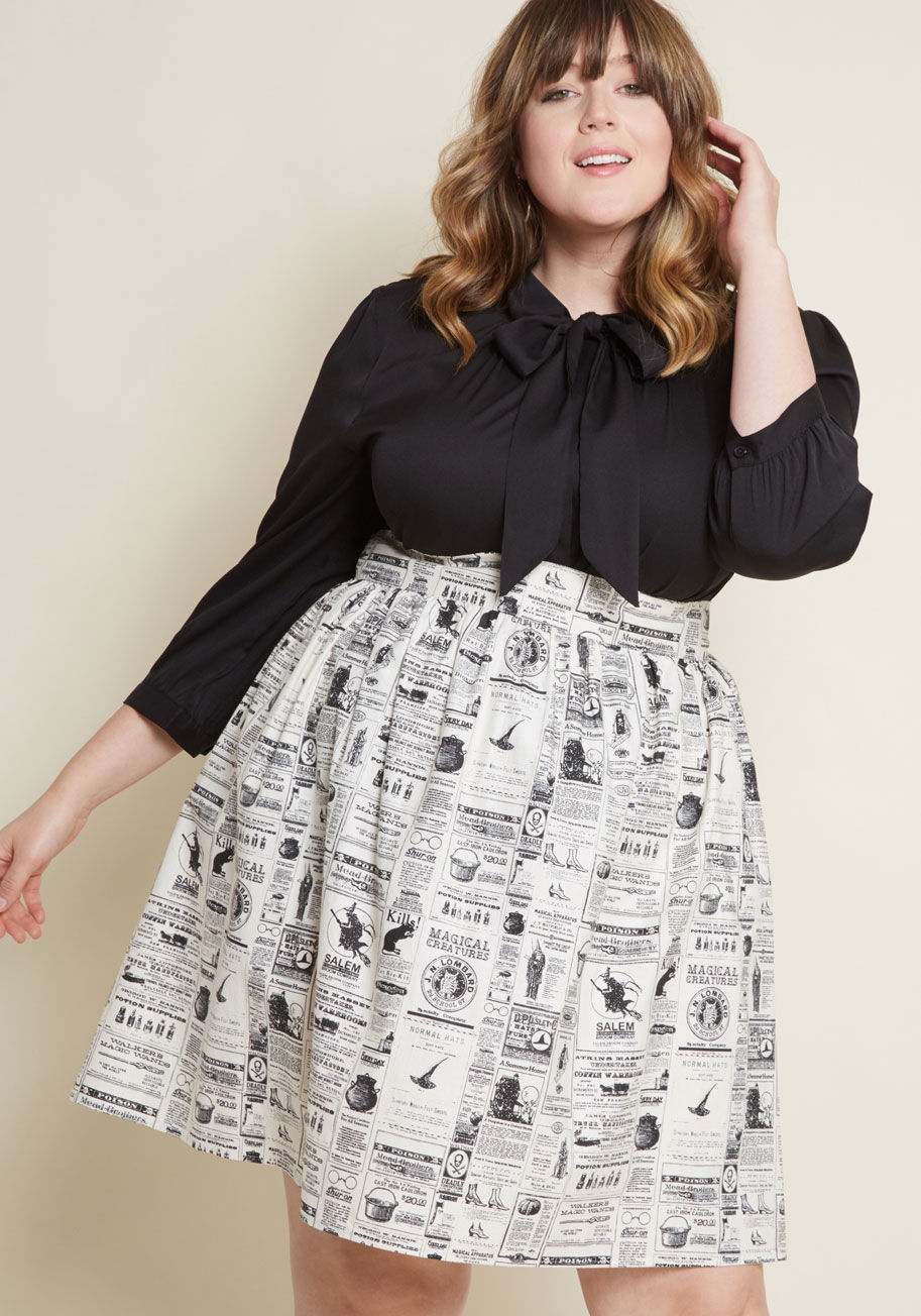 10104961_lively_vibe_cotton_a-line_skirt_in_spooky_newspaper_grey_black_PLUS-SIZE01.jpg