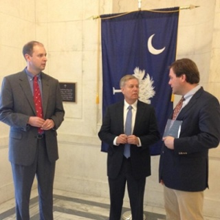 (LtoR) MHA Southeast Director Richard Sidebottom speaks with Sen. Linsday Graham and Charleston (R-SC) developer William Cogswell about the merits of HTCs.