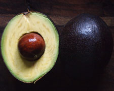 """Linda - Linda is a regular, heavy bearing tree with fruit that ripens in the spring. The avocados are large and roundish with a medium seed, dark purple skin when ripe. It is often referred to as the """"dieter's avocado"""" due to its lower oil content and good flavor."""