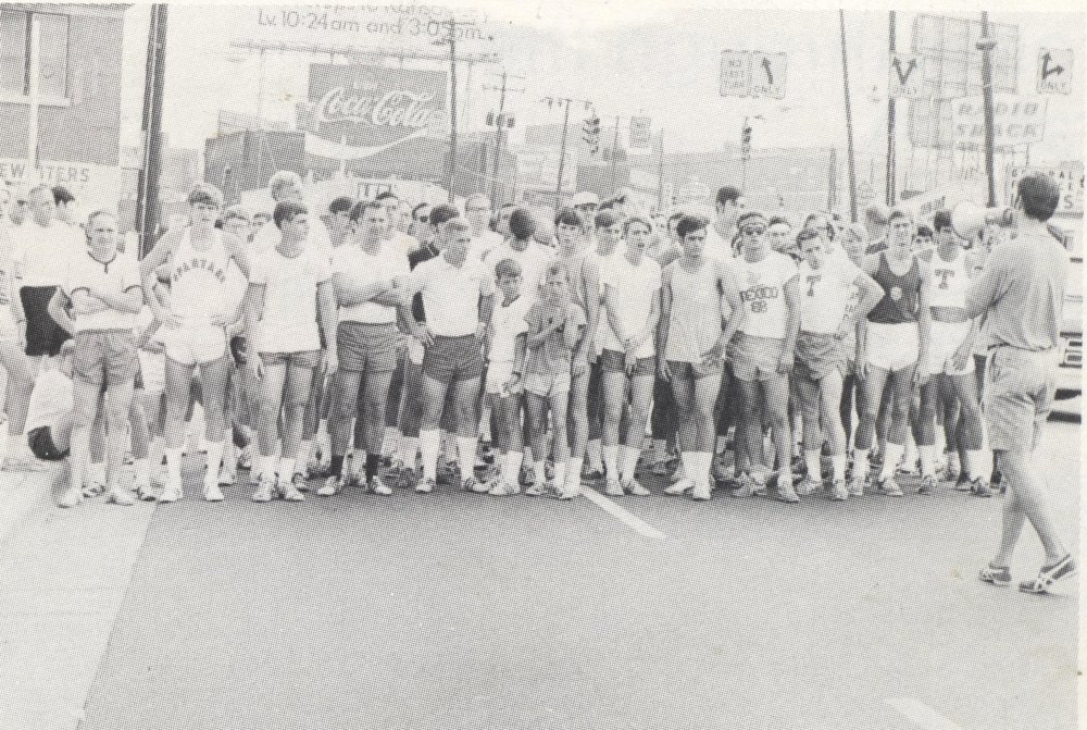 Start of the 1970 Peachtree Road Race. Race founder Tim Singleton holds the bullhorn.