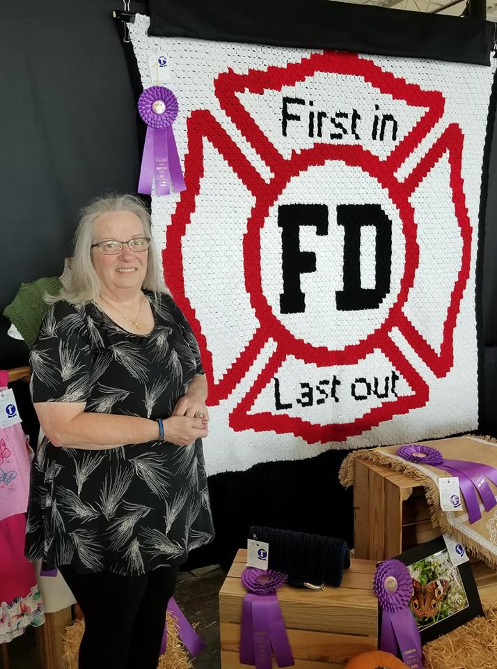 The Grand Prize goes to… - Louise Atkinson won the grand prize at her local fair and now is donating the Maltese Afghan to her local Fire Department!
