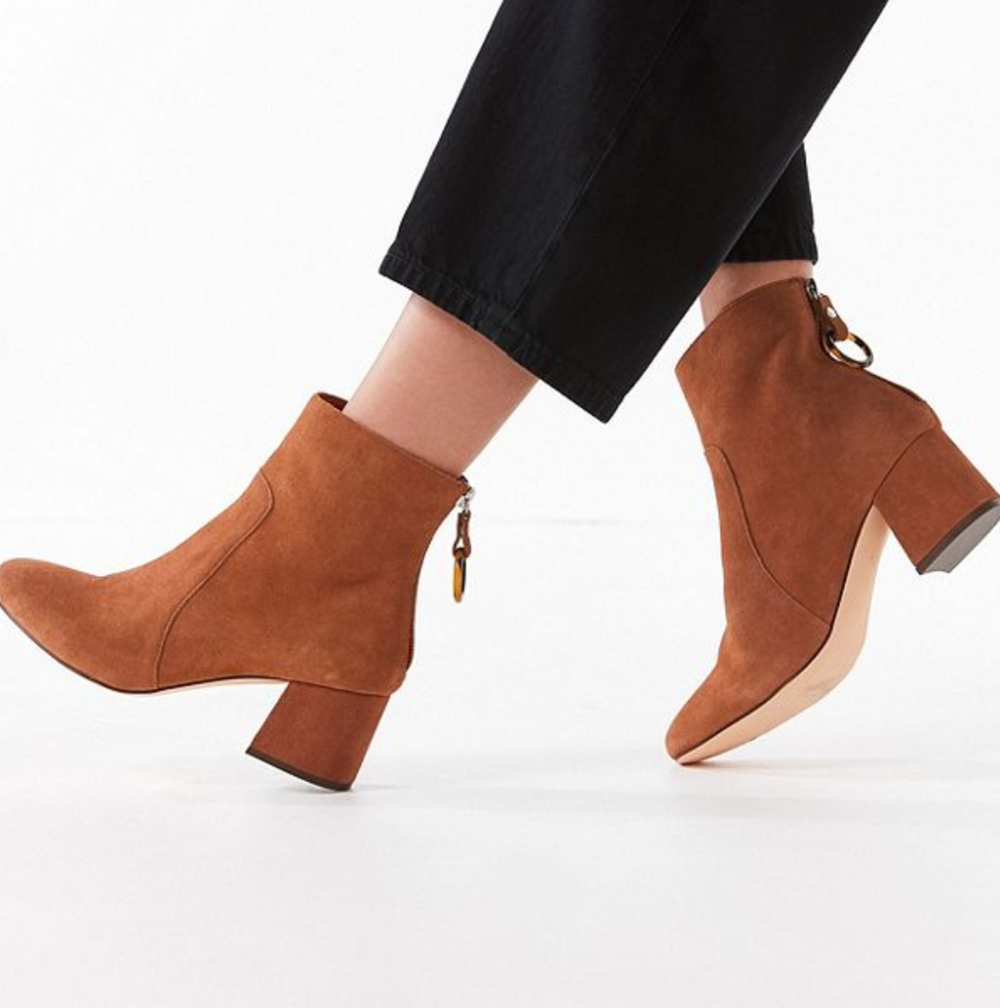 Ankle Boots - Ankle boots are some of the most versatile shoes. They look good with skirts, shorts, dresses, leggings, and jeans. Plus, we love them because they're altogether easy-to-wear and photogenic (Do it for the 'gram!). In case there's a chance of rain in your destination, don't think twice to bring ankle boots as they can protect your feet like no other. Choose flat or low-heeled boots for daytime, and opt for high-heeled boots for more formal evening events.