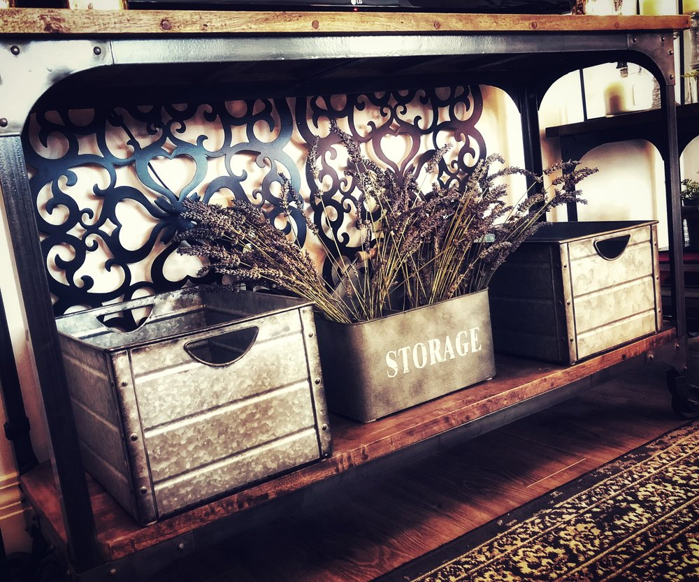 Galvanized metal bins  can give your storage a rustic vibe. Perfect for storing remotes, random knick-knacks, or even just some pretty flowers.