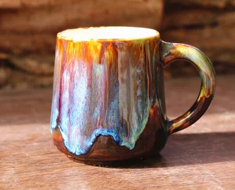 Utopia Life Studio Pottery Mug @ Etsy     This mug is just plain groovy.