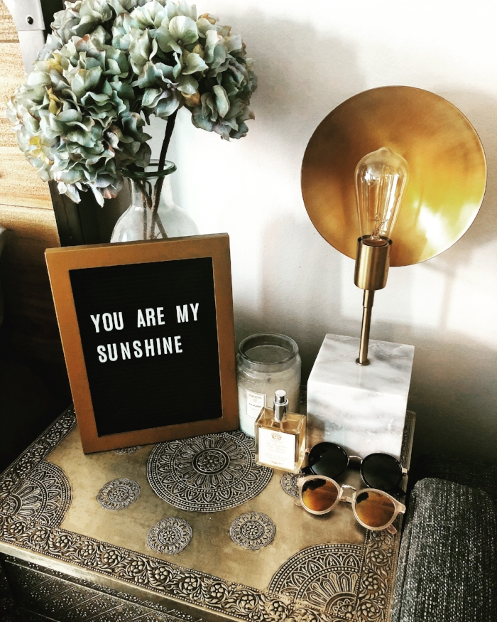 rustic nightstand decor with letter board.JPG