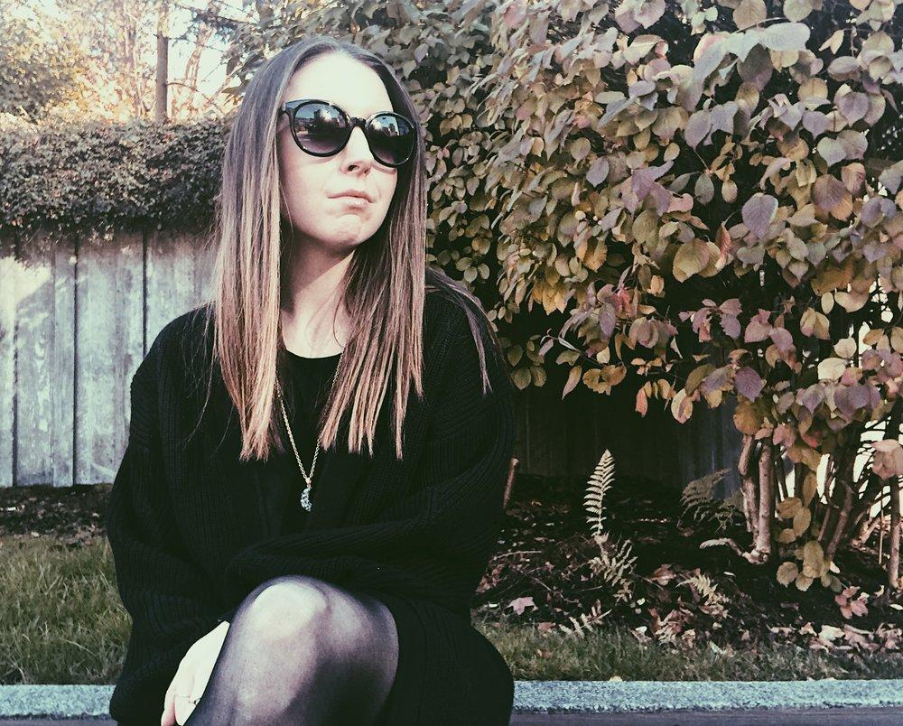 black sweater big sunglasses.jpg
