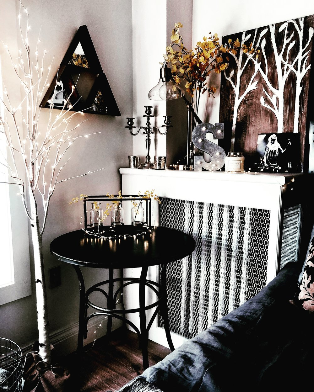 Rustic home decor with yellow faux florals and fairy lights