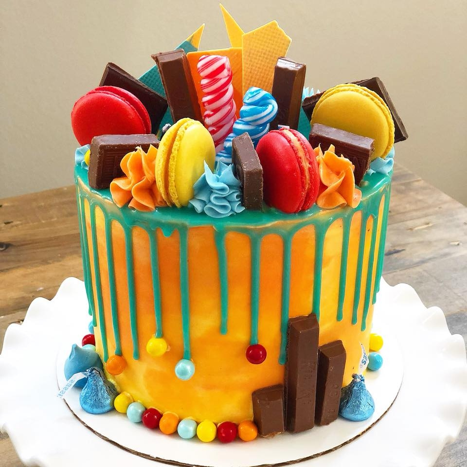 Custom Cakes - Drip baby, drip, common now, drip baby drip. What a better way to dress up a cake, than with some fun and colorful drips! Round buttercream cakes, dripped with chocolate, topped with macarons, candy bark and other sweet treats for a fun show-stopper. We also do themed cakes!
