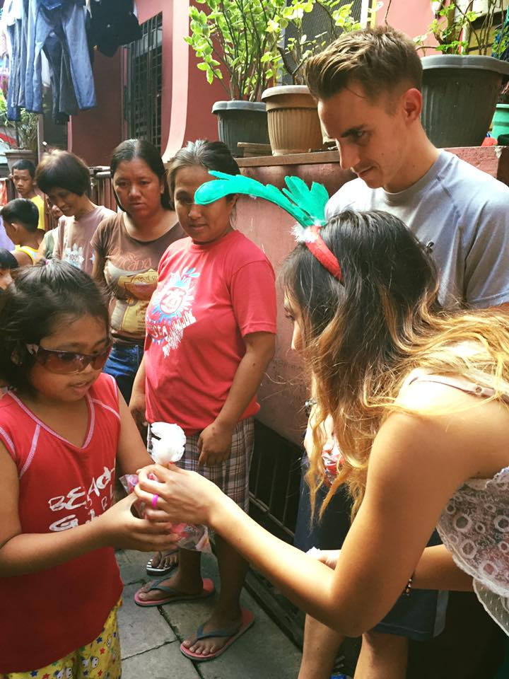 Giving Christmas candy to needy children in the most impoverished neighborhoods in Manila.