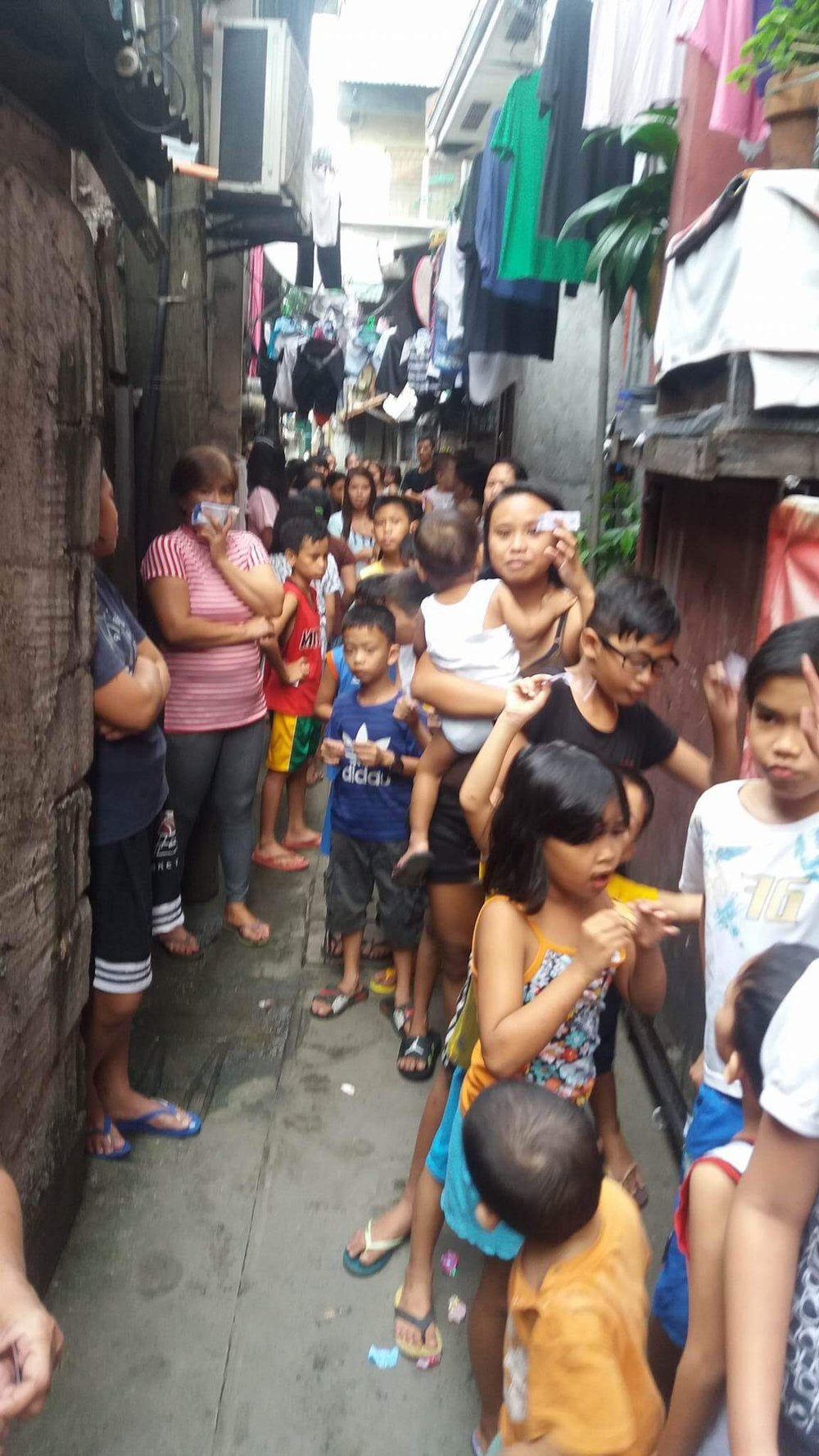 Hundreds of children line up to receive our sweets.