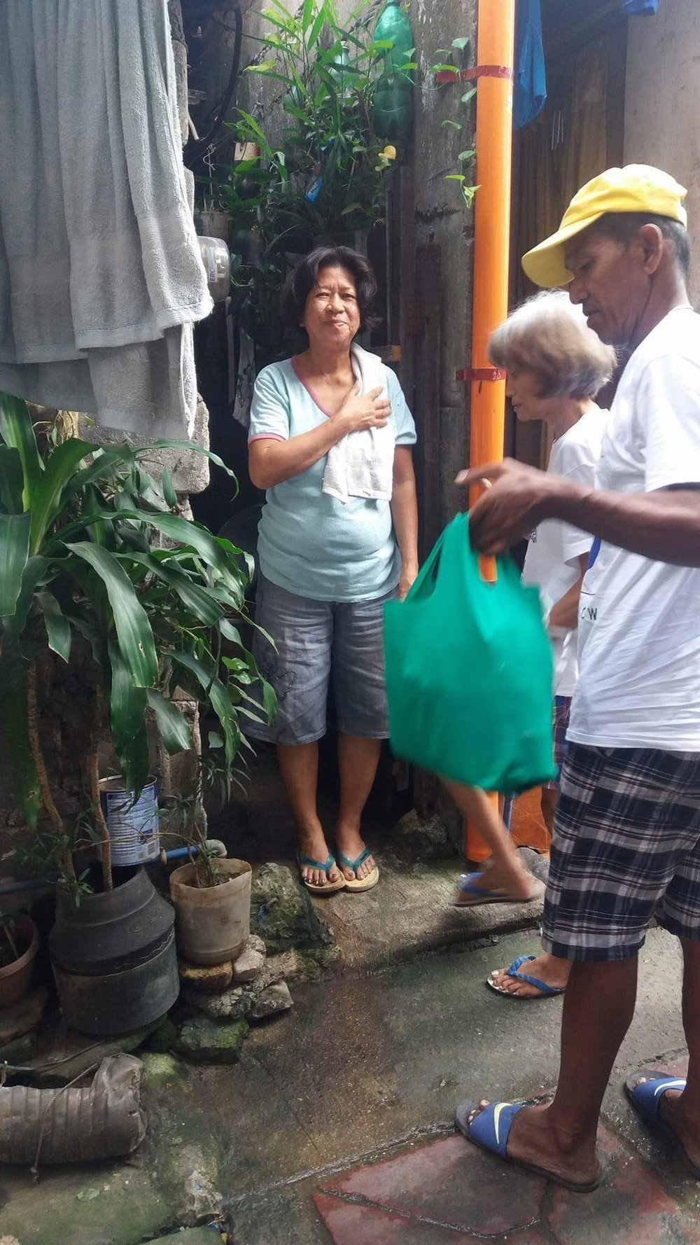This woman is grateful to receive food from Compassion Philippines.