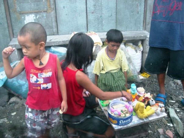 Kids playing on the street.