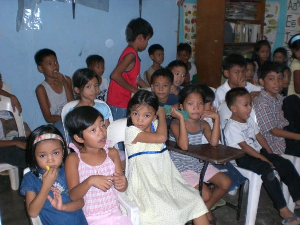 Kids getting ready for story time.