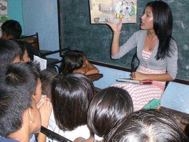 A volunteer reading Bible stories.