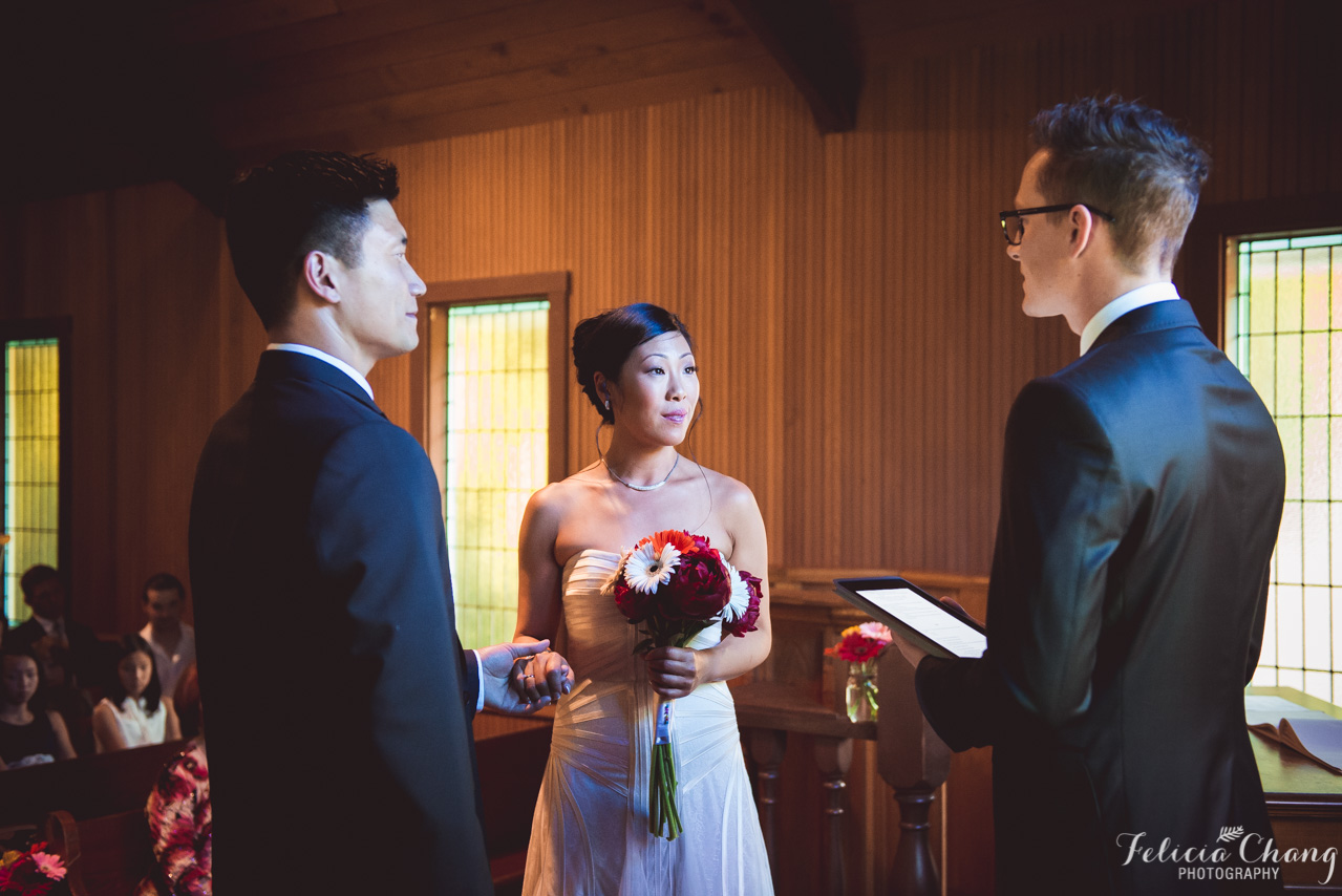 exchanging their vows at church wedding, pastor with iPad notes