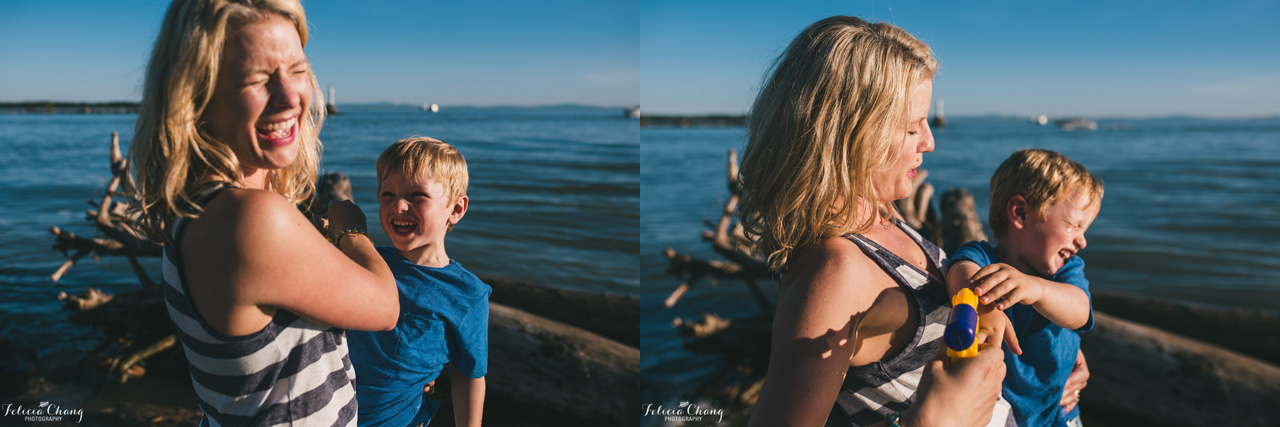 boy squirting mommy with water gun, vancouver family photographer, Felicia Chang Photography